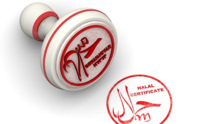 "Red seal and imprint ""HALAL"" on white surface"